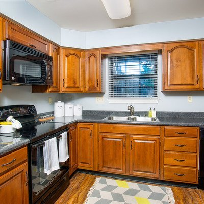 Gourmet kitchen with GE appliances, including a built-in microwave, dishwasher and disposal